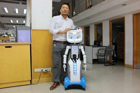 Dinsow Smart Robot For Old People Going Into Mass