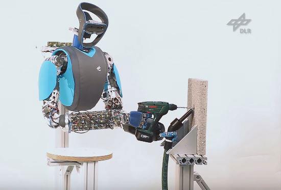 David Humanoid Robot Drilling Into Concrete Robotic Gizmos